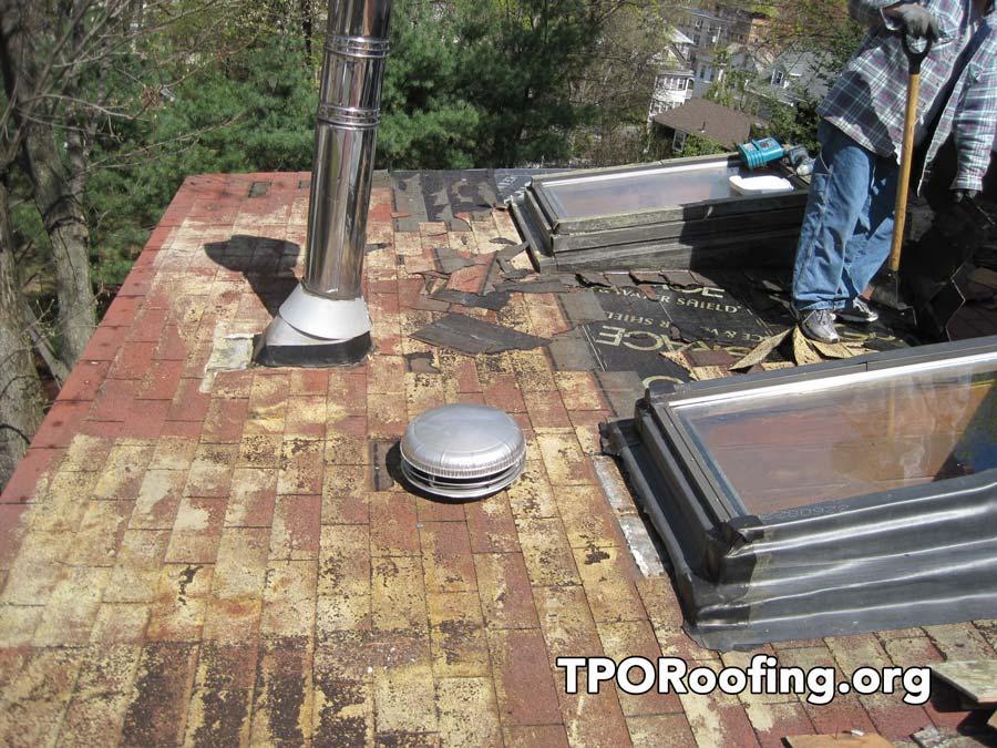 Rubber roof installed over Asphalt Shingles